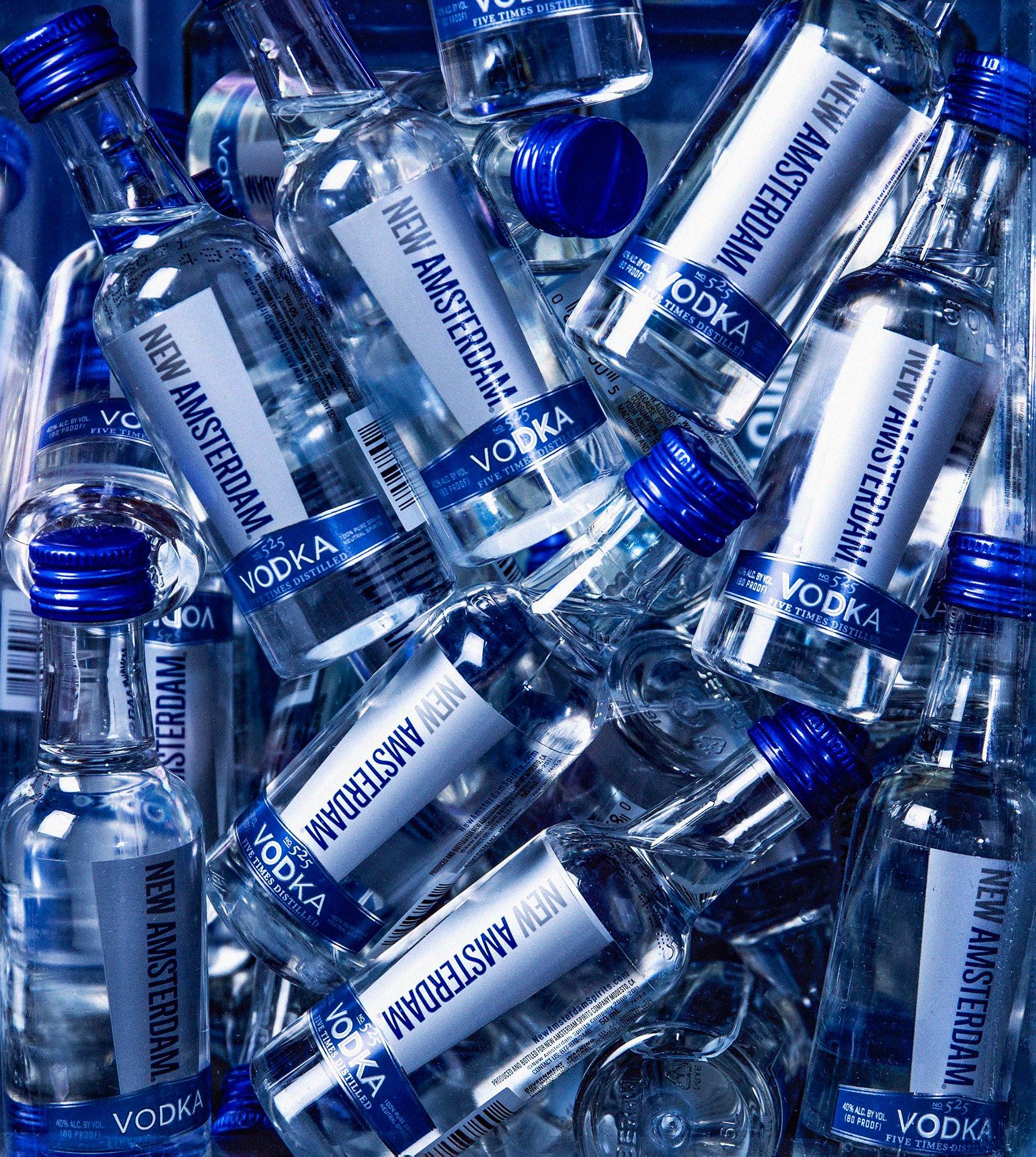 several bottles of New Amsterdam. Visit our Instagram.