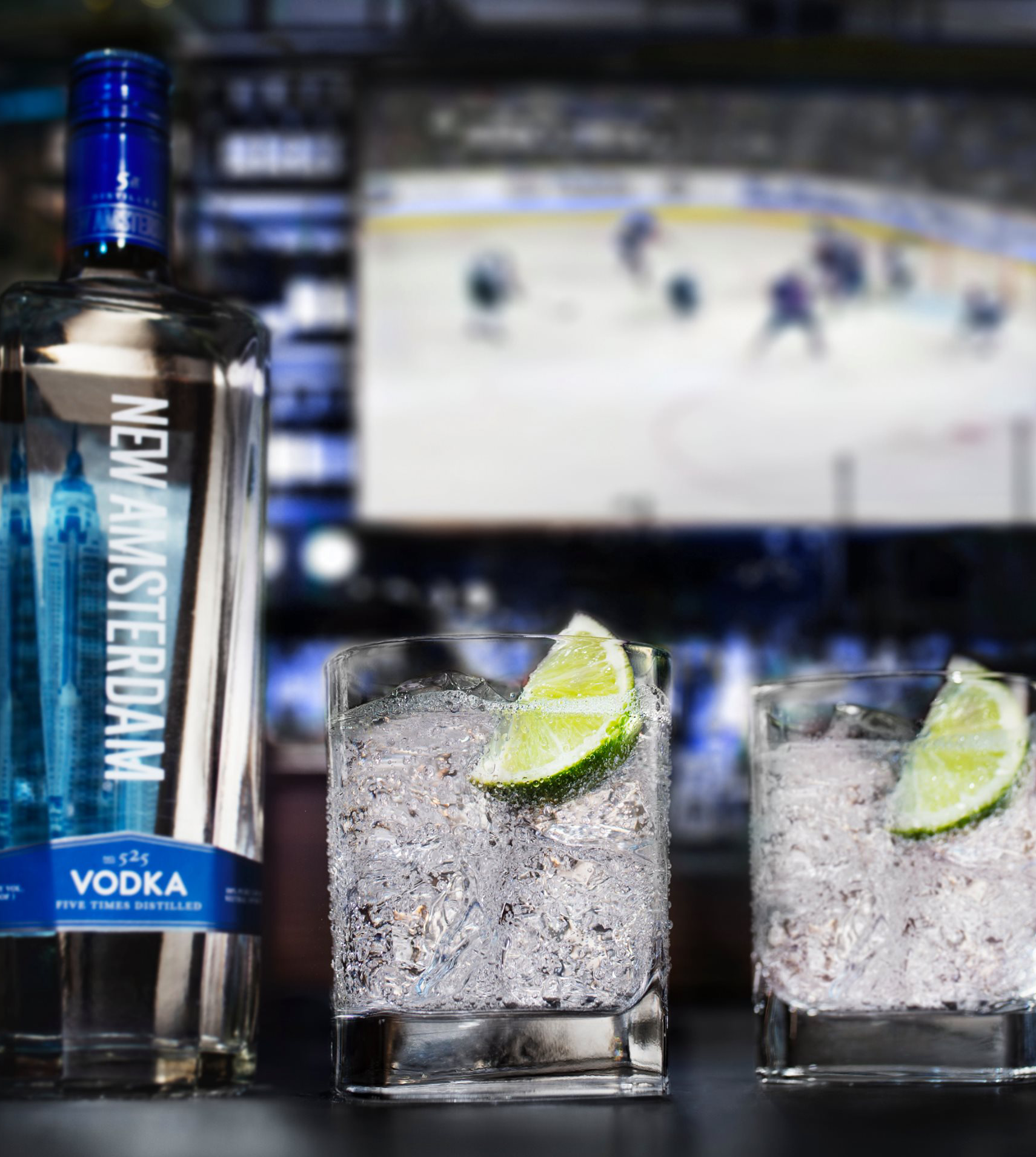 NAM Vodka poured into two glasses on the rocks with a lime