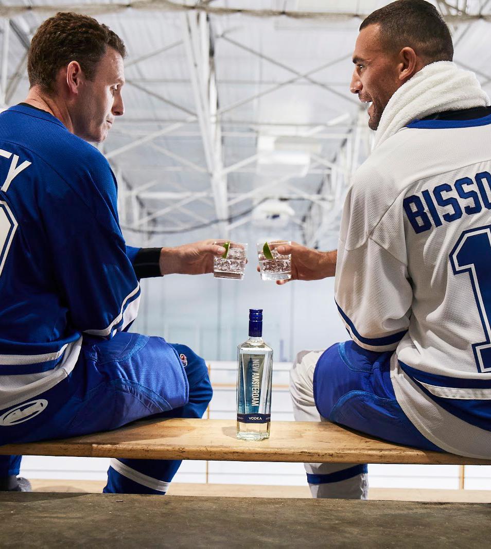 Enemy hockey players toasting over NAM Vodka